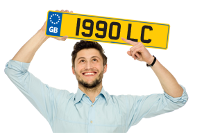 Guy holding a Birthday Number Plate