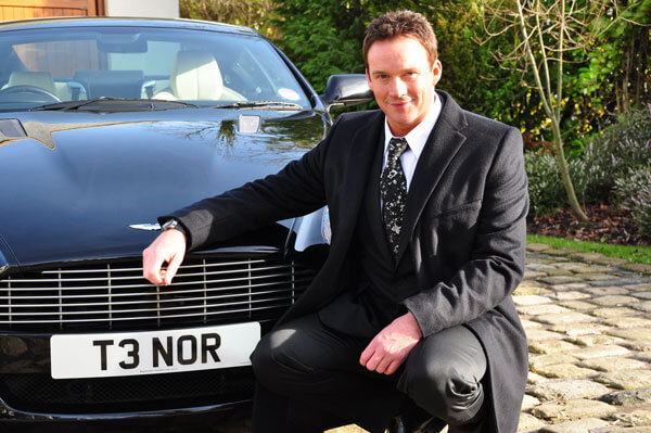 One of the UK's most well loved singers, Russell Watson poses with his T3 NOR personalised car registration