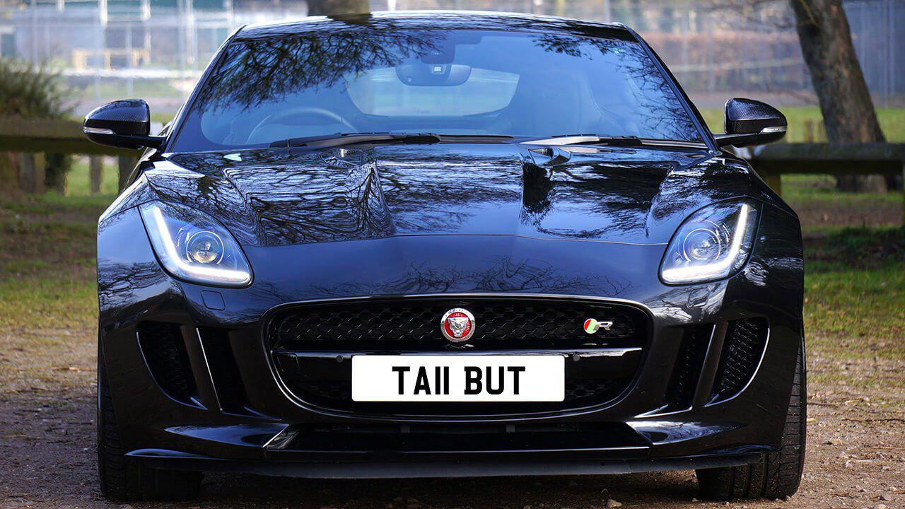 Car displaying the registration mark TA11 BUT